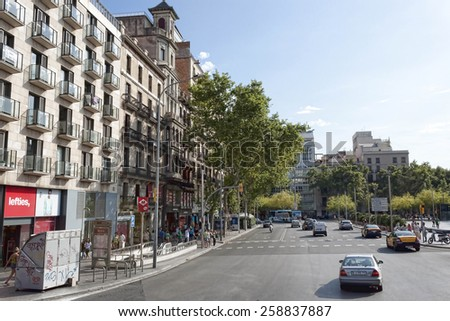 BARCELONA, SPAIN - JULY 13, 2013: Traffic on the streets of Barcelona