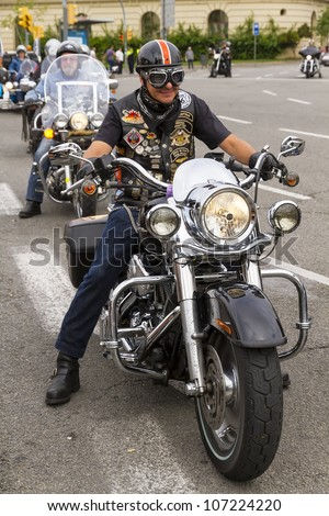 BARCELONA, SPAIN - JULY 08: Unidentified persons with a Harley Davidson motorbike at an exhibition during BARCELONA HARLEY DAYS 2012, on July 08, 2012, Barcelona, Spain.