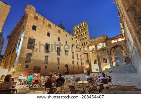 BARCELONA, SPAIN - JULY 30: Wide angle night composition of the medieval Placa del Rei in Barcelona, Spain on July 30, 2012. The square is dominated by the 14th century Palau Reial.