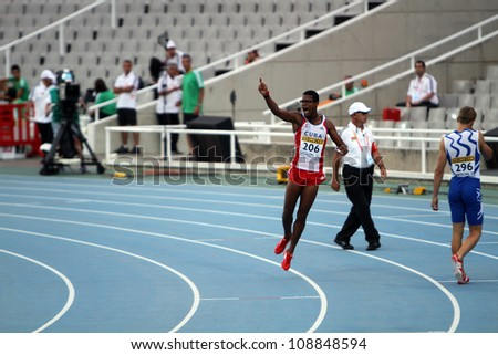 BARCELONA, SPAIN - JULY 12 : Yordan L. O'Farrill from Cuba celebrates winning of the 110 meters hurdles final on the 2012 IAAF World Junior Athletics Championships on July 12, 2012 in Barcelona, Spain - stock photo