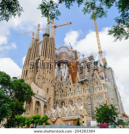BARCELONA, SPAIN - JUN 23, 2014: Basilica and Expiatory Church of the Holy Family, is a Roman Catholic church in Barcelona, Spain, designed by Antoni Gaudi. UNESCO World Heritage Site - stock photo