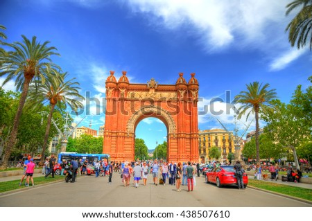 BARCELONA, SPAIN, JUN 16: Colorful HDR image of people visiting the Arc de Triomf in Barcelona, Spain on a partially cloudy spring day. Barcelona. June 16, 2016