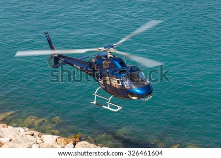BARCELONA, SPAIN - JUNE 27. Helicopter above the harbor of Barcelona on June 27, 2015. The rotorcraft offers Helicopter tours to sightseeing above Barcelona. The Heliport is in the marina Port Vell