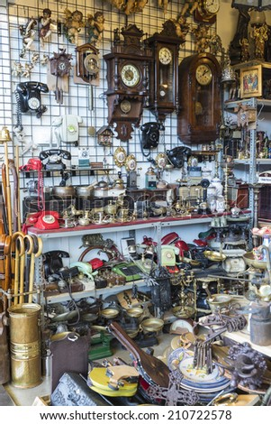 Barcelona, Spain - June 18, 2014: Objects used, furniture, artwork and ornaments on a market stall in the most famous flea market in Barcelona, also known as Els Encants or Els Encants Vells