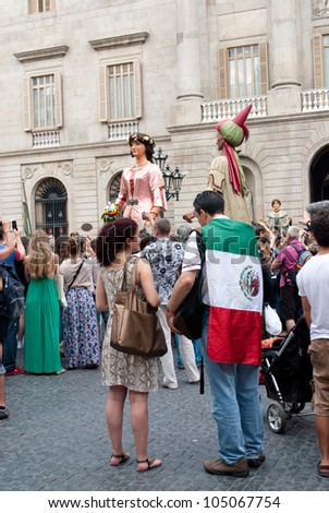 "BARCELONA, SPAIN. JUNE 1OTH: Unidentified Mexican citizens show they support to the ""#YoSoy132"" movement on 10/June/2012 in Barcelona Spain at the Pla�§a Sant Jaume."