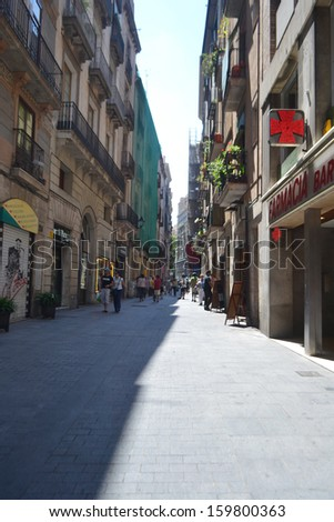 BARCELONA, SPAIN - JUNE 22: Street in center of Barcelona, Spain on June 22, 2013. Barcelona is the capital of Catalonia and the second largest city in Spain.
