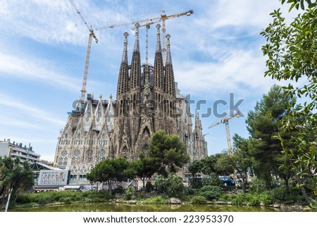 Barcelona, Spain - June 18, 2014: The Basilica i Temple Expiatori de la Sagrada Familia, is a large Roman Catholic church in Barcelona, Spain, designed by Catalan architect Antoni Gaudi. - stock photo