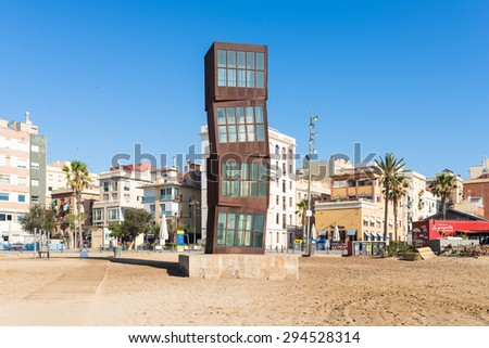 BARCELONA, SPAIN - JUNE 29. The beach of Barceloneta with the sculpture L Estel Ferit in Barcelona on June 29, 2016. The beach is in close to down town and very popular below young tourists - stock photo