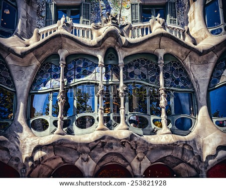BARCELONA, SPAIN - JUNE 27, 2014:The facade of the house Casa Battlo (also could the house of bones) designed by Antoni Gaudi. Processed in the graphic editor. Processed in the graphic editor. - stock photo