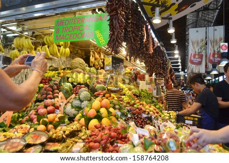 BARCELONA, SPAIN - JUNE 22: The famous St Joseph Food Market in the Eixample district of Barcelona, Catalonia, Spain on June 22, 2013. - stock photo