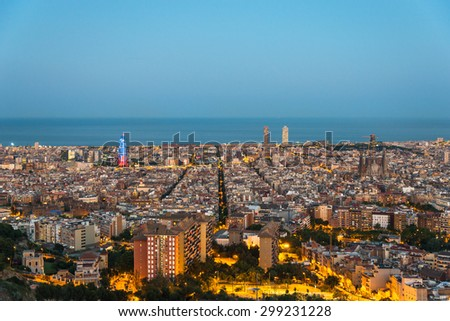 BARCELONA, SPAIN - JUNE 29. Top view and night photography from an illuminated Barcelona. The panorama shows the famous Sagrada Familia, the illuminated Torre Agbar and the Towers of the Port Olimpic - stock photo