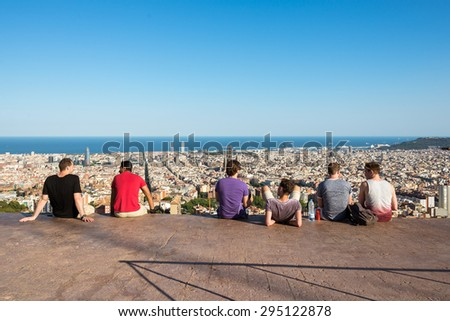 BARCELONA, SPAIN - JUNE 29. Young people are watching the skyline of Barcelona on June 29, 2015. The Torre Agbar in the district Poblenou. The Sagrada Familia and, the Towers of the Port Olimpic - stock photo