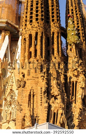 BARCELONA, SPAIN - MAR 15, 2014: Basilica and Expiatory Church of the Holy Family, is a Roman Catholic church in Barcelona, Spain, designed by Antoni Gaudi. UNESCO World Heritage Site - stock photo