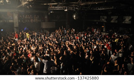 BARCELONA, SPAIN - MARCH 18: Large crowd of spanish fans waiting for a concert at Razzmatazz on March 13, 2011 in Barcelona, Spain. Razzmatazz is considered one of the best discoteques of the world. - stock photo