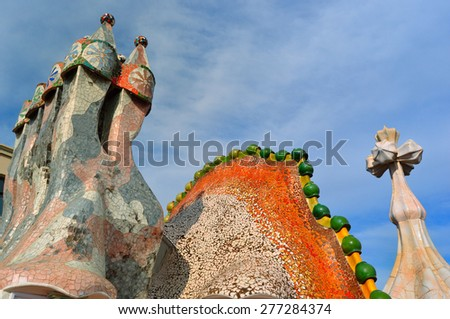 BARCELONA,SPAIN - MARCH 18, 2015: Rooftop of the house Casa Battlo (also called the house of bones) designed by Antoni Gaudi with his famous expressionistic style on March 18, 2015 Barcelona, Spain - stock photo