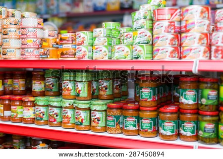 BARCELONA, SPAIN - MARCH 22, 2015: Shelves with canned goods at groceries section of average Polish supermarket