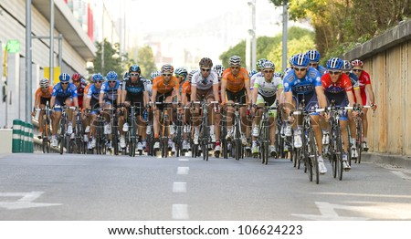 BARCELONA, SPAIN - MARCH 24: Some unidentified cyclists compete at Volta a Catalunya cycling race, on March 24, 2012, in Barcelona, Spain.