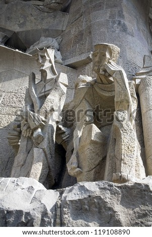 BARCELONA, SPAIN - MARCH 15: The Sagrada Fami­lia is a privately-funded Roman Catholic church that has been under construction in Barcelona since 1882 in Barcelona, Spain on March 15, 2010. - stock photo