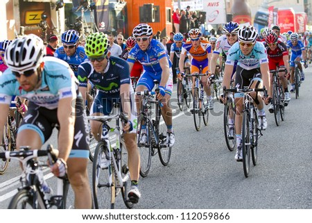 BARCELONA, SPAIN - MARCH 24: Unidentified cyclists compete at Volta a Catalunya cycling race, on March 24, 2012, in Barcelona, Spain.