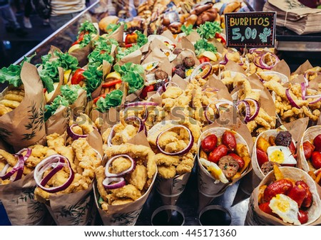 Barcelona, Spain - May 28, 2015. A stand with burritos at market called La Boqueria, foremost tourist landmarks in Barcelona