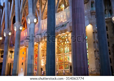 BARCELONA, SPAIN - MAY 02: Architectural Interior Detail of Pillars and Stained Glass Inside Sagrada Familia Church, Designed by Antoni Gaudi, Barcelona, Spain. May 02, 2015. - stock photo