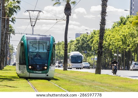 Barcelona, Spain - May 21, 2015: Barcelona tram known as Trambaix. In the picture the tram is going through the Diagonal avenue