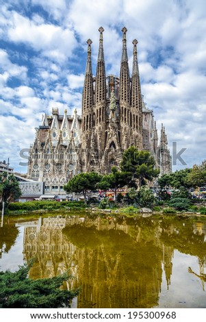 BARCELONA, SPAIN - MAY 17, 2014: Basilica and Expiatory Church of the Holy Family by Gaudi, building is begun in 1882 and completion is planned in 2030  - stock photo