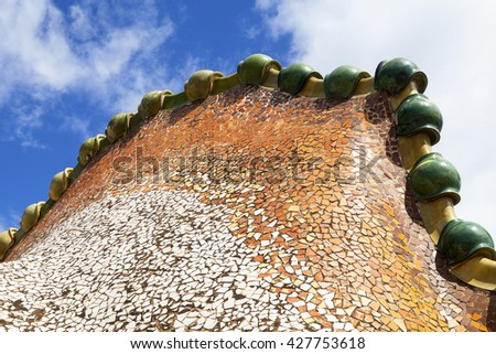 BARCELONA, SPAIN - MAY 11,2016 : Casa Batllo,  housetop , details, ceramic mosaic. Building  redesigned in 1904 by Gaudi located in the center of Barcelona, it  is on the UNESCO World Heritage Site. - stock photo