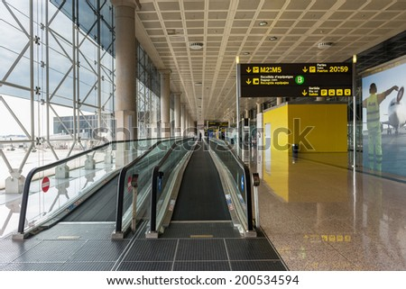 BARCELONA, SPAIN - MAY 30, 2014: Corridor inside El Prat International Airport. The airport is the second largest in Spain and 31st busiest in the world, and is the main airport of Catalonia.