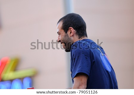 BARCELONA, SPAIN - MAY 13: Javier Mascherano, F.C Barcelona player, celebrates Spanish League victory with thousand of fans in the streets on May 13, 2011 in Barcelona, Spain. - stock photo