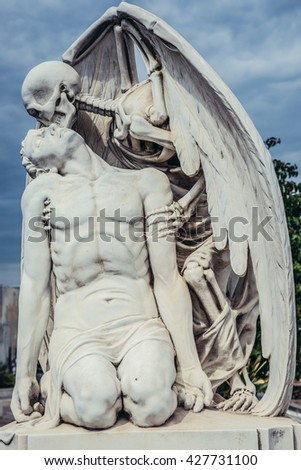 Barcelona, Spain - May 24, 2015: kiss of death statue at Poblenou Cemetery in Barcelona - stock photo