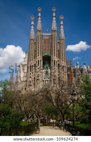 BARCELONA, SPAIN - MAY 5: La Sagrada Familia - cathedral designed by Gaudi, which is being built since 19 March 1882 and is not finished yet May 5, 2012 in Barcelona, Spain. - stock photo