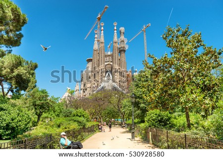 BARCELONA SPAIN - May 21 2016 La Sagrada Familia - View from the green park to the cathedral designed by Antonio Gaudi, which is still under construction at May 21, 2016 in Barcelona, Spain.