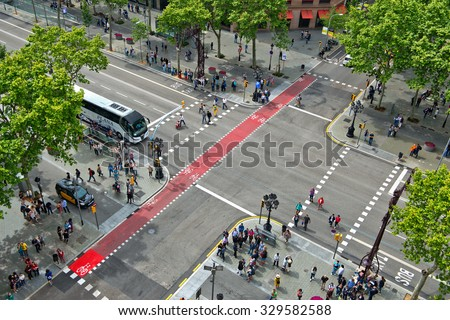 BARCELONA, SPAIN - MAY 02: Looking Down at Busy Street Intersection with Pedestrian Cross Walks, as seen from Casa Mila, Barcelona, Spain. May 02, 2015