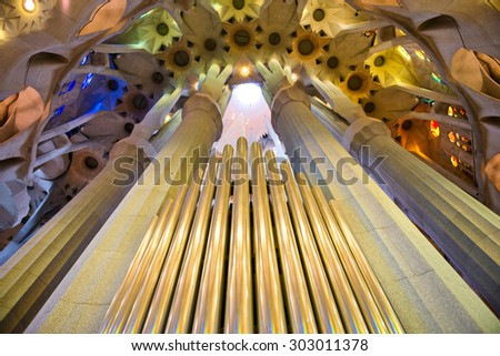 BARCELONA, SPAIN - MAY 02: Organ pipes and ceiling, Sagrada Familia, Barceloni , Spain, a Roman Catholic church design by Antoni Gaudi to resemble branching trees. May 02, 2015 in Barcelona Spain - stock photo