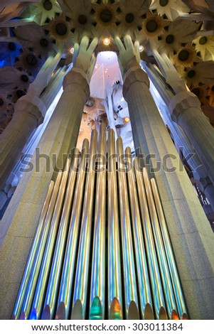BARCELONA, SPAIN - MAY 02: Organ pipes in the Sagrada Familia, Barcelona, Spain between fluted columns designed by Antoni Gaudi to resemble branching trees. May 02, 2015 in Barcelona Spain - stock photo