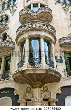 BARCELONA, SPAIN - MAY 02:Ornate semi-circular Art Nouveau balcony and bay window on the exterior of a historic stone Spanish building in Barcelona, Spain. May 02, 2015 in Barcelona Spain - stock photo