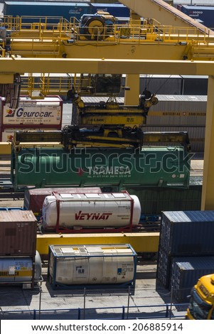 Barcelona, Spain - May 14, 2014: Overview of Container Terminal in the port of Barcelona where there are all kinds of containers, vats and new cars for export