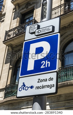 Barcelona, Spain - May 26, 2015: Signal indicating an electric charging station for electric motorbikes and cars with parking for two hours
