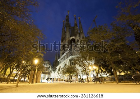 BARCELONA, SPAIN - MAY 3, 2015: The Basilica of La Sagrada Familia at night. Designed by Antoni Gaudi, its construction began in 1882 and is not finished yet on May  - stock photo