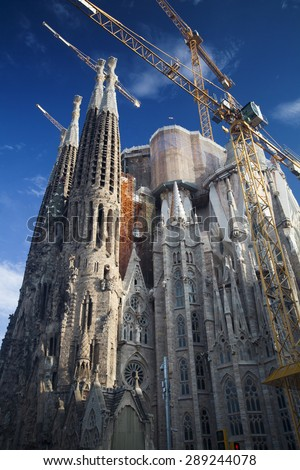 BARCELONA, SPAIN - MAY 3, 2015: The Basilica of La Sagrada Familia designed by Antoni Gaudi, its construction began in 1882 and is not finished yet. - stock photo