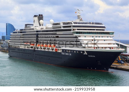 BARCELONA SPAIN - MAY 19 2014:The Noordam (Holland America) at port and ready to sail for the Mediterranean,with capacity of 2044 passengers. It was christened in New York by actress Marlee Matlin. - stock photo