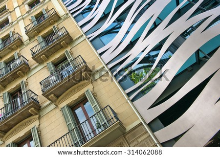 BARCELONA, SPAIN - MAY 02: Tilted Architectural Detail View of Old and New Neighboring Buildings Located on Passeig de Gracia, Barcelona, Spain. May 02, 2015. - stock photo