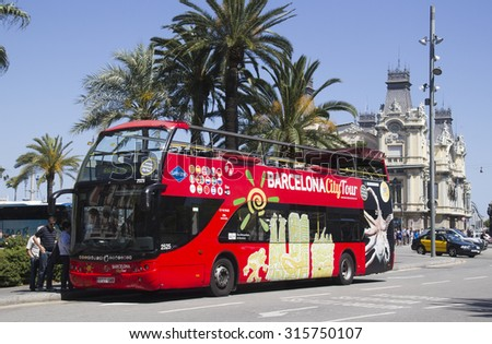 Barcelona, Spain - May 22, 2015: Tourists get on a double decker tour bus for an excursion in the harbor area of Barcelona, Spain on May 22, 2015.