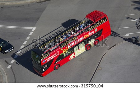 Barcelona, Spain - May 23, 2015: Tourists in an excursion bus seen from above in Barcelona, Spain on May 23, 2015.