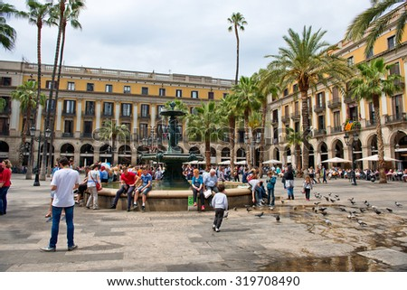 BARCELONA, SPAIN - MAY 02: View of Bustling Placa Reial - Tourists Gathered Around Central Water Fountain in Placa Reial, Barcelona, Spain, May 02, 2015 - stock photo