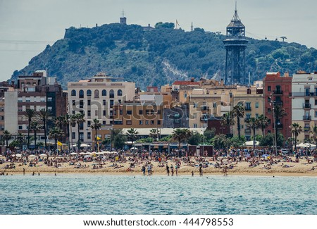 Barcelona, Spain - May 24, 2015. View of La Barceloneta beach and Montjuic Hill on background