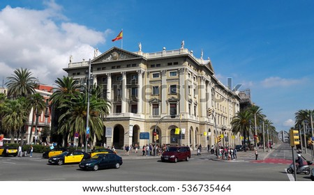BARCELONA, SPAIN - 09.25.2016: Military Government Building with typical black and yellow Barcelona taxis in the front