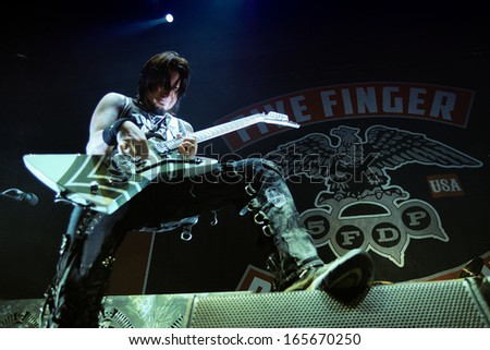 BARCELONA, SPAIN - NOV 25: Five Finger Death Punch (5FDP), heavy metal band, performs at Pavello Olimpic de Badalona stage on November 25, 2013 in Barcelona, Spain. - stock photo