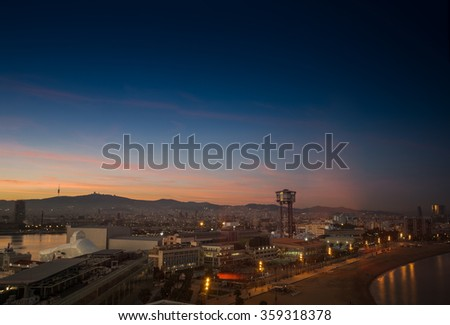 BARCELONA, SPAIN - NOVEMBER 10, 2015: Aerial view of the Vell port of Barcelona and Barceloneta beach with funicular tower on November 10, 2015 in Barcelona, Spain. It is Catalonia's largest port.  - stock photo